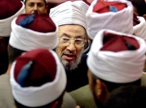 """Il religioso Yusuf al Qaradawi: """"Unitevi ai ribelli contro Assad"""" (Afp)"""